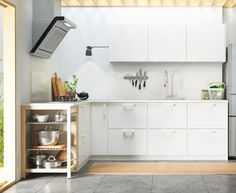 Metod kitchen with Veddinge white doors, drawer fronts and Maximera soft-closing drawers, $2875, styled with Eriksdal handles and knobs and Ekbacken worktop