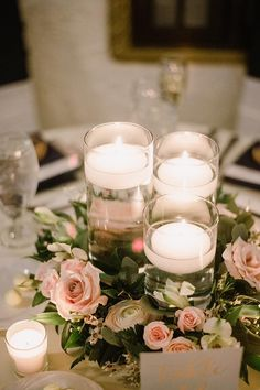 Beautiful floating candles with a floral wreath around it for a reception centerpiece. Floating Candle Centerpieces, Wedding Table Centerpieces, Wedding Decorations, Centrepieces, Wedding Ideas, Floating Candles Wedding, Candle Arrangements, Floral Wedding, Floral Wreath