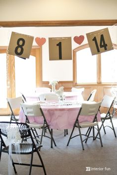 Easy and super cute banner for a bridal shower made from simple cardstock  ribbon! Other sweet shower decor and food items including a cupcake dress! #weddingshower #bridalshower