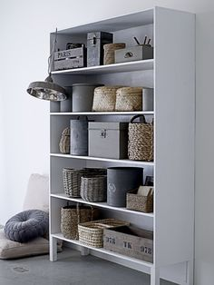 Baskets and shelves = honorary cupboard. bloomingville s/s 2012