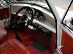 Classic mini cooper with a red leather interior.