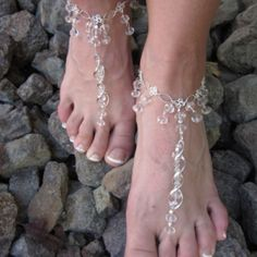 Silver with a twist Barefoot sandals at the Shopping Mall, $35.00
