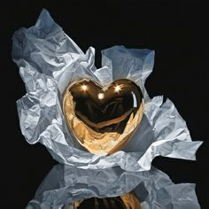 AN UNWRAPPED GOLD HEART !!!!