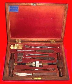 Max Wocher. Trephine Set in Rosewood Box. Scalpels, Trephines, Chisel, a Lenticular and a Double-Ended Elevator Forceps, and a Trephine Brush. Made in Cincinatti, Ohio. Circa 1840's. Trephine Sets were Used for Cutting Out Circular Holes in Bone, usually the Skull, to Relieve Pressure on the Brain or for Surgery.