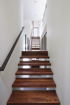 ultra-wide stairs with beautifully-grained wood, wedged in between the two walls