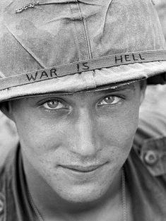 """An unidentified U. Army personnel wears a hand lettered """"War Is Hell"""" slogan on his helmet, June during the Vietnam War. He was with the Airborne Brigade Battalion on defense duty at Phouc Vinh airstrip in South Vietnam. Danang Vietnam, South Vietnam, Hanoi Vietnam, Vietnam Travel, American Soldiers, American Civil War, Native American, Vietnam Tattoo, Fotojournalismus"""