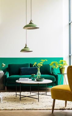 The Turin two-seater sofa in emerald green velvet. Sleek tapered legs and a minimal shape give it an elegant look, while a layer of feathers in the cushions and seat make it as comfortable as it is stylish.