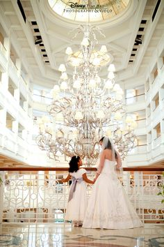 Iconic shot of a bride and her flower girl in the lobby of Disney's Grand Floridian #Disney #wedding #GrandFloridian #flowergirl