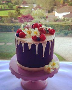 Chocolate drip cake with summer berries.