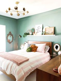 Pink and green bedroom decor.  This room blends midcentury modern with glam details that look like victorian details.