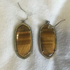Kendra Scott Elle Earrings Tiger's Eye Kendra Scott Elle Earrings. These are tarnished but Kendra Scott is great about exchanging tarnished items for free! Kendra Scott Jewelry Earrings