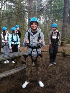 Louis climbing a tree. I see 2 things i wanna climb. LOL