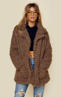 """Channel your inner Penny Lane with this furry jacket from Sage The Label! This piece will carry you through the colder weather with its luxe faux fur fabrication, open front with draped collar, and full lining. ImportedDry Clean OnlyPoly BlendFit Guide:Model is 5ft 8 inches; Bust: 34"""", Waist: 25"""", Hips: 36""""Model is wearing a size XSRelaxed FitShoes Featured Not Available For Purchase"""