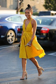 Mellow yellow: The 28-year-old actress cut a beautiful figure in a bright yellow dress with a sweet full skirt and sexy plunging neckline as she headed out for an early dinner with pals after attending a pre-BET Award event