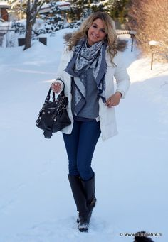 gray and blue scarf / white coat / gray sweater / blue jeans / black boots / black bag
