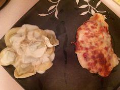 Chicken parmesean with a sideof tortellini with alfredo
