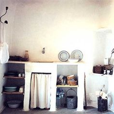 Old school Greek kitchen | Not all that long ago, you might run across a kitchen similar to this one in some of the older Athenian homes; they still exist in many traditional island and mountain villages. Today, however, most Greek kitchens look like those you would find anywhere in Europe: heavy on the IKEA cabinetry, maybe a bit contemporary Italian in taste. Smaller than American kitchens, for sure.