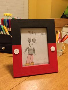 DIY Mickey Mouse picture frame with buttons.