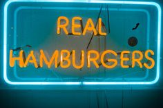 Real Hamburgers...because a fake one would be bad. (That is the exact kind of joke I make about signs like these all the time.)