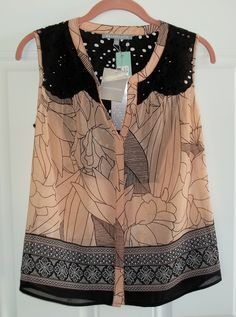 """July 2016 Stitch Fix. Daniel Rainn Kroes Eyelet Detail Top. 100% Polyester sheer outer layer, comes with black cami. XSP measures 24"""" long. https://www.stitchfix.com/referral/4292370"""