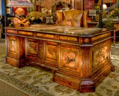 """Benedict Desk:  Unique in design and scale. This beautiful leather inlaid top and burl wood give grandeur to any office setting.    80"""" L x 41"""" D x 31 1/2"""" H  www.brumbaughs.com 817.244.9377"""
