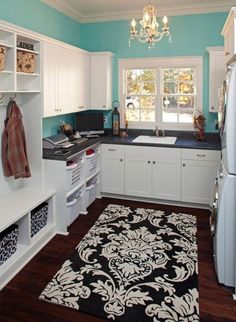 Your laundry doesn't have to drab and boring. Make it fun and a place where you would want to spend time in. Adding the patterned area rug is a great idea for a focal point and excitement in this space.