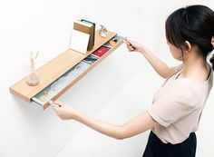 Clopen Shelf by Torafu Architects - the storage is hidden - you need the magnet 'key' to open it