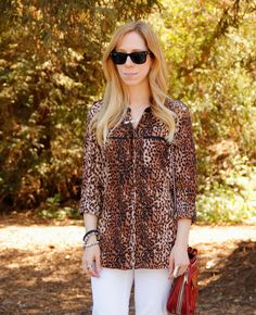 Fashion Blogger wearing our cheetah print blouse with white jeans for #summer #style #thekeytochic