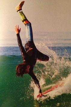 handplant on a surf board