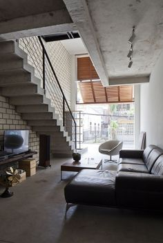 MM++ architects townhouse with a folding-up shutter ho chi minh city vietnam designboom Narrow House Designs, Modern Townhouse, Concrete Houses, Industrial House, Ideal Home, Home And Living, Living Room, Small Spaces, Interior Design