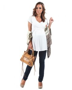 £19.99 - The perfect fresh white short sleeve nursing top for every day - our bestselling short sleeved breastfeeding top.  Ties to the back or front and wraps around your bump for a new look everyday. Discreet breastfeeding panels ensure you can wear this from the first day of your pregnancy and no-one would ever know you were planning to nurse your baby. Soft stretchy jersey fabric flatters your changing shape. 94% viscose 6% elastane. Average length from side of neck to hem 29' / 74cm