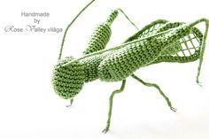 crochet green grasshopper on white table, rose valley photo, inspiration, home decor, christmas, xmas, organizing, wedding, field, insect, arthropod, macro, animal, amigurumi, toy, horgolt, zöld, szöcske, minden, alakalomra, esküvő, karácsony, születésnap, fotó