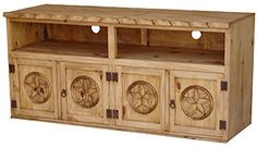 Place your television on top of this large rustic Santana Star TV Stand with Bunn Feet. The TV stand has an extra-large open shelf, ideal for a cable box, game consoles and multimedia players. Rustic Pine Furniture, Mexican Furniture, Southwestern Home, Mexico House, Tv Cabinets, Solid Pine, Panel Doors, Cubbies, Open Shelving