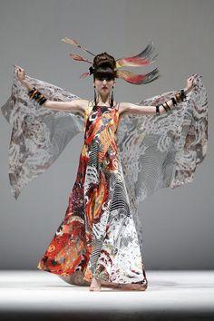 A model showcases designs by Yumi Katsura during Japan Couture 2012 Singapore at The Shoppes at Marina Bay Sands on November 28, 2012