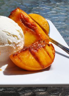 Grilled Peaches! WILL be doing this weekend! Combining recipes by using peach halves rolled in brown sugar/vanilla, fill pit area with blueberries and place in foil pack, pull out when done to sear skin side on grill for flavor...put on top of pound cake drizzle with rasberry sauce and to with whipped cream.....Delicious!