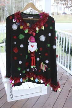15 DIY Ugly Christmas Sweaters you can make! Get creative and make your own Ugly Christmas Sweater with these 15 tacky Christmas Sweaters ideas! Tacky Christmas Party, Best Christmas Songs, Diy Ugly Christmas Sweater, Ugly Sweater Party, Christmas Jumpers, Christmas Shirts, Xmas Sweaters, Christmas Stuff, Christmas Time