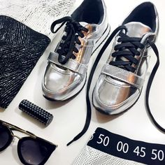 Futuristic Metallic Leather Sneakers Details: • Size 5 • Leather • Lace up front • Rubber sole • Brand new in box  02191605 Charles David Shoes Sneakers