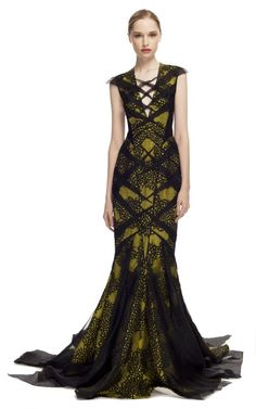 This fitted evening gown features sheer cap ...