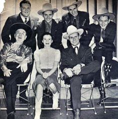 """Gene Autry and his """"Melody Ranch"""" radio show gang: (L-R top) announcer Tom Hanlon, The Rough Riders Trio (Jimmy Wakely, Johnny Bond, Dick Reinhart). (L-R seated) Shorty Long as portrayed by Horace Murphy, Mary Lee and Gene Autry."""
