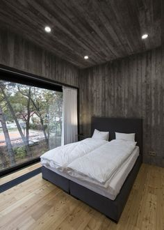 Inviting Residence With A Concrete Shell And Wood Cladding