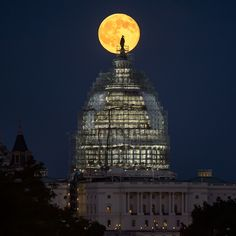 The second full moon of July 2015, a so-called Blue Moon, rises behind the dome of the U.S. Capitol in this amazing view by NASA photographer Bill Ingalls in Washington, D.C. on July 31, 2015.