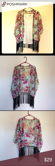Alythea Floral Kimono. One Size. Blue and pink floral kimono by Alythea. Has sleeves and black tassels along the bottom. Lightly worn. One size. Bloomingdale's Tops