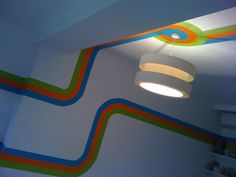Painted ceilings are a signature move! 1960s/retro/space age inspired racing stripe!