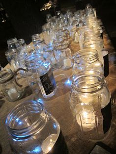 Mason jars with chalkboard paint as luminaria  The Roaring Twenties (mine that is...)  @Rosalie B, there are some great ideas on the Roaring 20s Party board. Love this one and the mason jars as place card seatings.