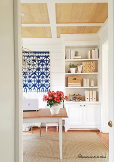 A dining room is turned office, but it also used for those special family meals.