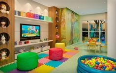 This looks like a fun nursery room. I like everything except the foamy tile floors.