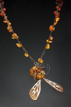 "Necklace |  Emi Savacool.  ""Worker's Repose"" (2011).  Carved boxwood, sterling silver, black onyx, mica, amber, solar quartz, dyes.  | Photo by Ken Yanoviak"