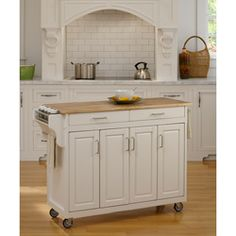 @Overstock - This Create-a-Cart is constructed of a durable solid hardwood and has a white finish to coordinate with many decors. This cart features four wood cabinets for storage, adjustable shelves, a spice rack, a towel bar and locking rubber casters for mobility.http://www.overstock.com/Home-Garden/Home-Styles-White-Wood-Top-Create-a-Cart/6605125/product.html?CID=214117 $325.99