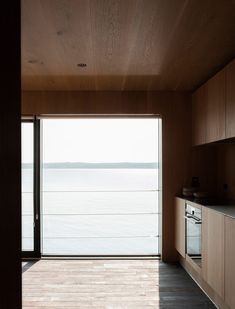 Oak also lines the surrounding walls and ceilings, while the floor is inlaid with handmade ceramic bricks. Timber Planks, Timber Beams, Timber Cladding, Minimal Living, Minimal Home, Timber Kitchen, Timber House, Facade House, Maine House