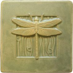 My dragonfly tile in green tea glaze. Part of our Contemporary Craftsman line.  You can find it at medicinebluffstudio.com